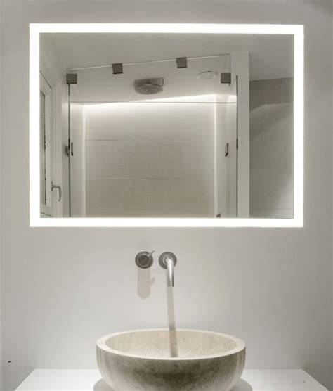bathroom mirror with lights behind copenhagen penthouse by dannish architects norm architects