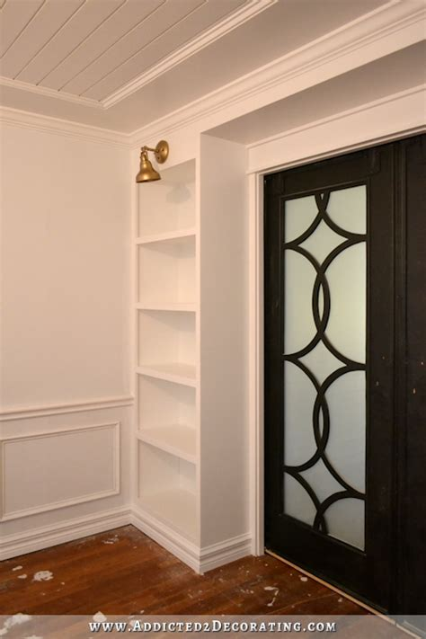decorative bookcases with doors diy pocket door bookcases finished