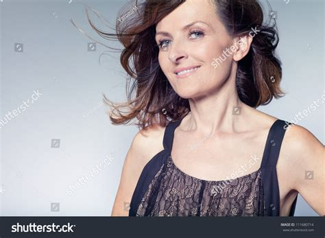 attractive middle aged hair attractive happy middle aged woman with curly hair stock