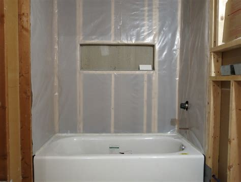 installing the vapor barrier for the bathroom shower blog homeandawaywithlisa