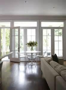 Wallof french doors and transom windows contemporary dining room