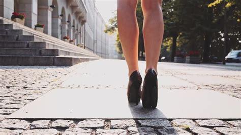 Roadmap To Beautiful Legs by Legs In Black High Heels Shoes Walking In The