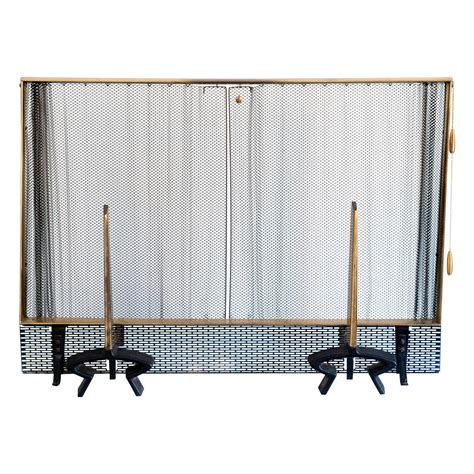 fireplace screen and andirons by donald deskey for