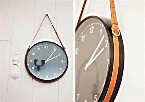 diy leather belt clock hanger diy ikea clock with leather belt hanger remodelista