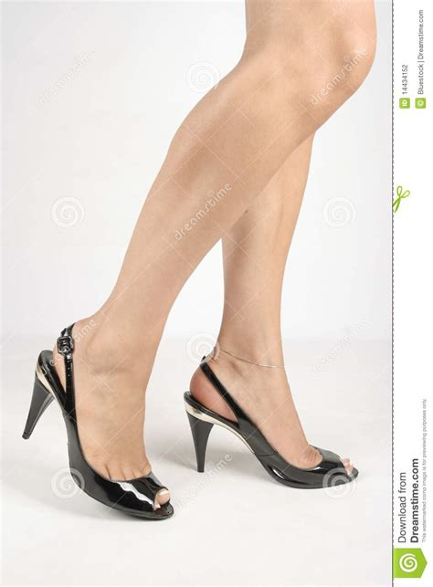 legs with black high heel shoes white stock