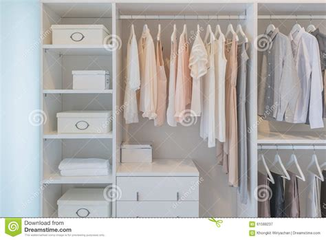 Wardrobe Clothes Hanging Rail by Clothes Hanging On Rail In White Wardrobe Stock Photo