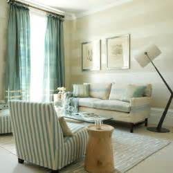 With striped living room wallpaper striped sofas and teal curtains
