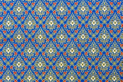 what are these pattern you observe thai patterns in blue and gold on silk fabric stock image