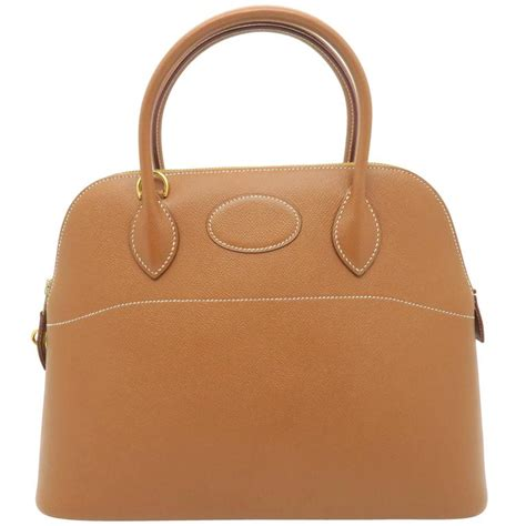 Wwd Top 12 Designer Handbag Brands Of 2007 by Hermes Bolide 31 Gold Brown Courchevel Leather Gold Metal