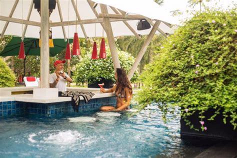 enjoy  sunny day soaking   swim  jacuzzi bar