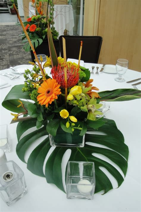 table flower centerpieces tropical floral centerpieces wedding flowers decorations glasses centerpieces