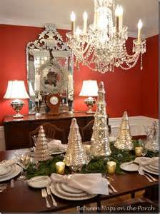 Setting with mercury glass christmas trees and a deer head centerpiece