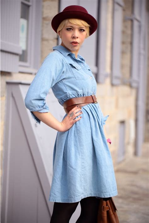 dark brown belt light brown shoes light blue denim dress with brown belt dark red hat and