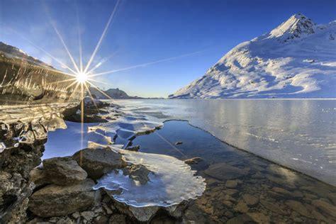 sun shining  icicles   shores  lake