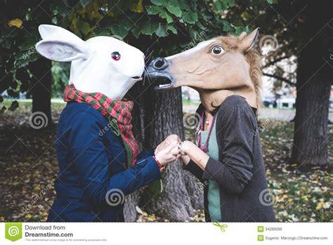 horse  rabbit mask women   park royalty  stock