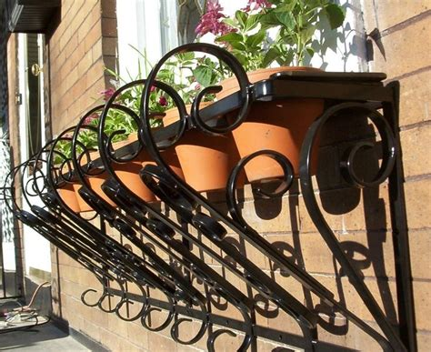 wrought wrought iron wall planters adastra