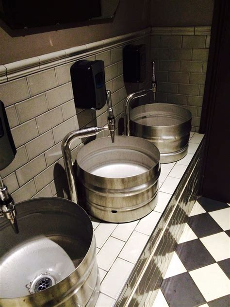 cool bar bathrooms cool barrel sinks and beer pump taps at restaurant rare in