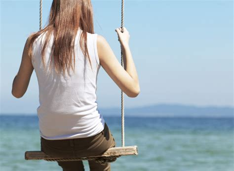 woman on a swing it always comes back to self care aspiremag net