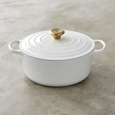 le creuset signature cast iron oven with gold knob