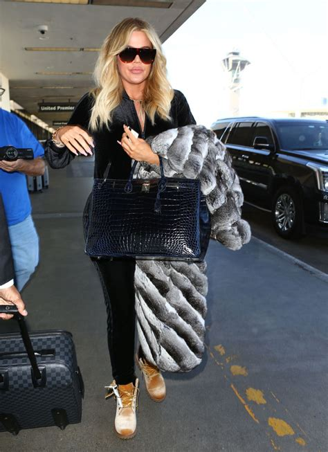 airport tarmac lax kim kardashian game khloe kardashian at lax airport in los angeles