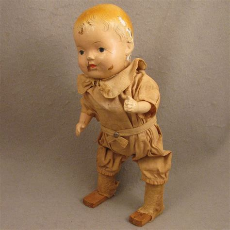 composition walking doll early 1900s american composition mechanical walking doll