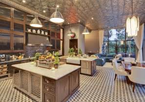 Kitchen has two islands and a tin ceiling