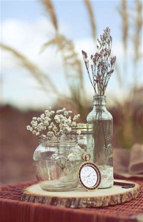pretty centerpiece bottles and dried flowers on the cut