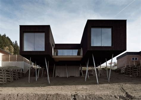 austrian s house is elevated on stilts so a lush garden