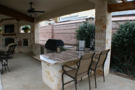 fort worth covered patio with pergola outdoor kitchen and