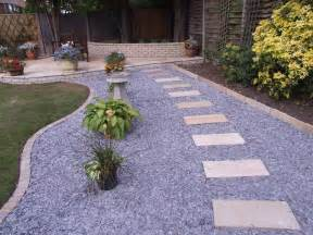 an english garden is cozy with a gravel road look paving