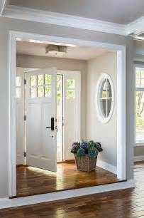 white front door foyer nook with basil flush mount transitional