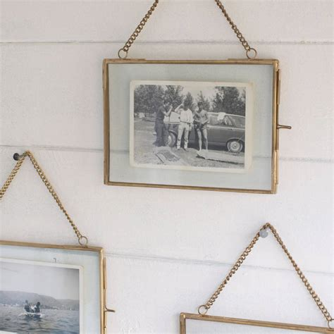 frame hanging hanging brass photo frame by idyll home notonthehighstreet com