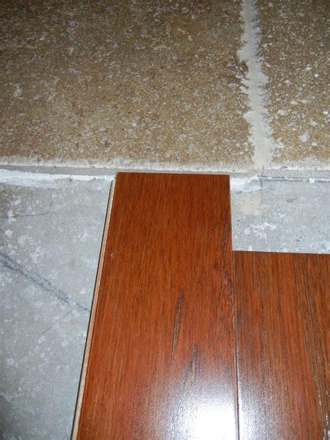 Transition   travertine to engineered wood flooring