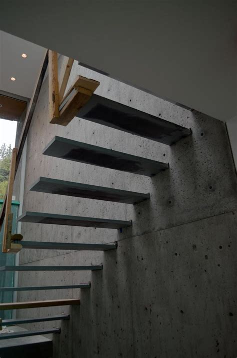 Exterior Concrete Cantilevered Stair Frontal steel cantilevered steps attached to concrete wall stair home stairs and cases