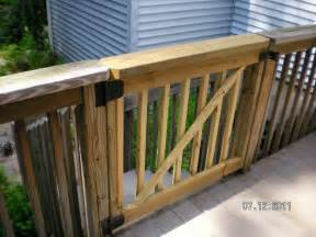 deck gates for dogs stairs into side yard for dogs concrete pad at bottom of stairs decks