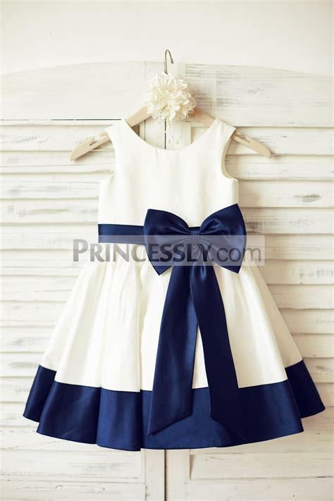 ivory satin sleeveless flower dress with navy blue belt bow avivaly