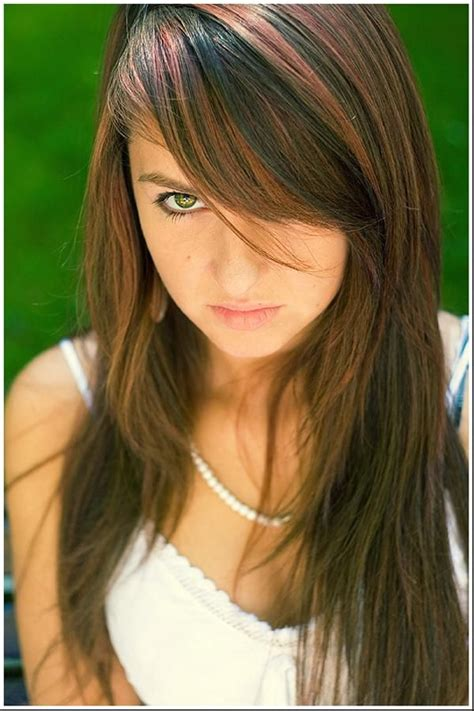 hairstyles with highlights and bangs layered hair with heavy side bang and cool multi colored