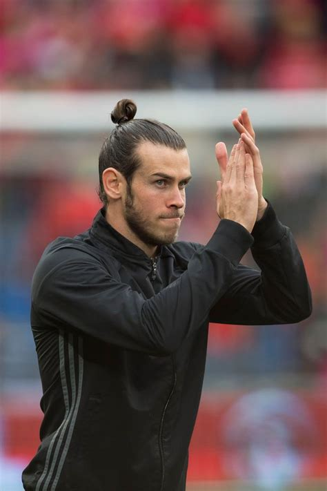 gareth bales long hair gareth bale s man bun collapses to reveal exactly what his
