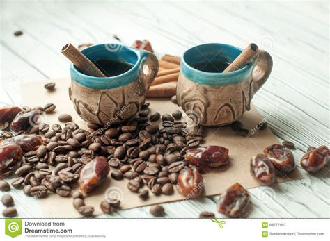Coffee Di Coffee Bean two cups of coffee with coffee beans royalty free stock