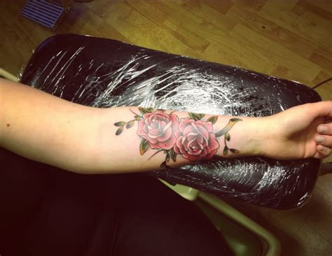 two roses on left forearm by aisha