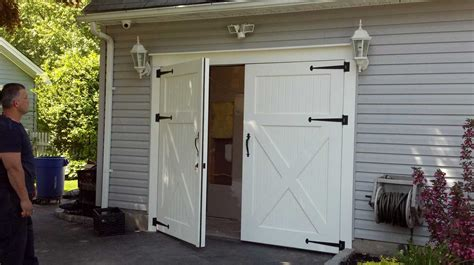 White Barn Style Garage Doors Combine With Gray Wall Paint Barn Style Shed Doors