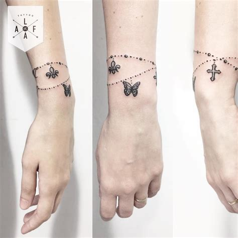 butterfly and cross bracelet tattoo designs tattoos