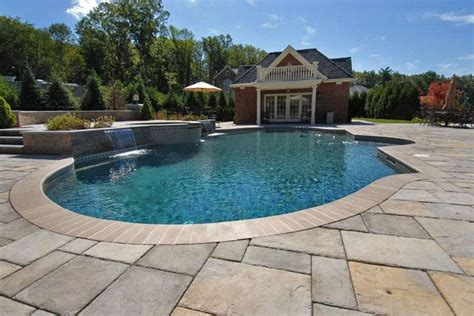 swimming pool pavers designed and installed by environmental pools gunite swimming pool with paver slab deck and