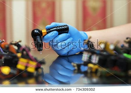 tattoo machine sparks industrial worker protective mask welding inox stock photo