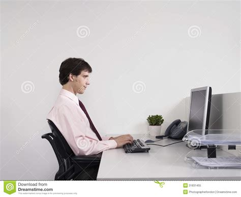 Office Worker At Desk Office Worker Using Computer At Desk Royalty Free Stock Photo Image 31831455