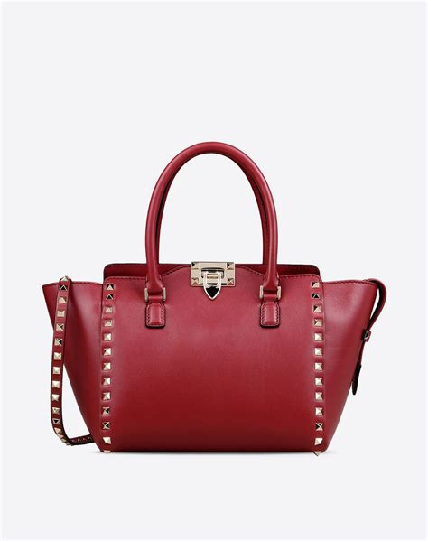 Sale Valentino Small valentino rockstud small leather handle bag in lyst