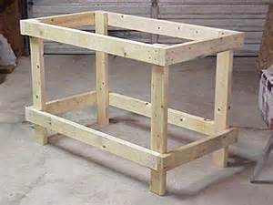 How To Make Simple Wooden Shelf Brackets by How To Build A Low Cost Sturdy Work Bench From 2x4 S And Osb
