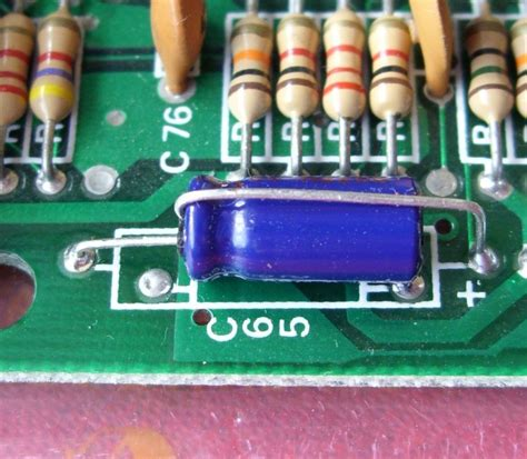 bent capacitor on motherboard capacitors