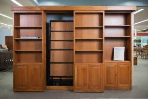 murphy bed bookshelves sliding bookcase murphy bed haus custom furniture