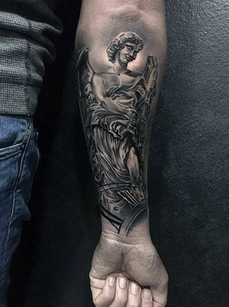 angel tattoo on forearm 40 statue designs for carved ink